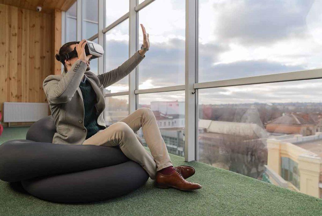 modern business man looking through virtual reality headset